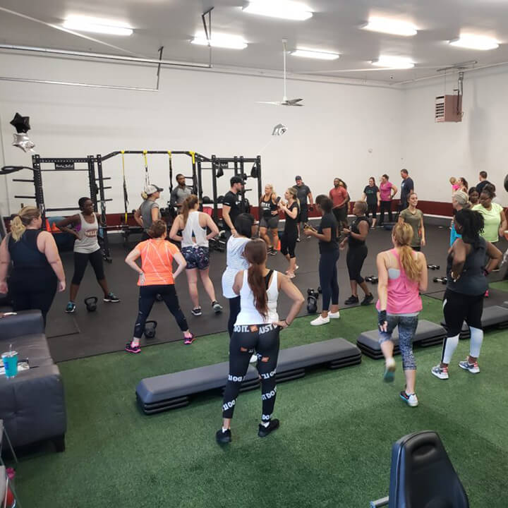 large fitness class warming up