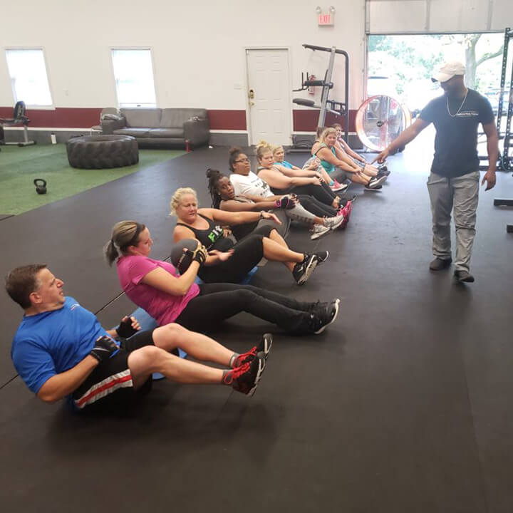 group of people on a gym floor exercising